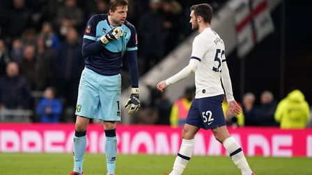 Tim Krul talks to Tottenham's Troy Parrott before his penalty in the shoot-out - the kidology worked