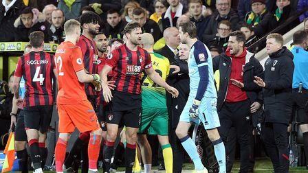Bournemouth Manager Eddie Howe tries to clam things down as tempers flare whilst Referee Paul Tierne
