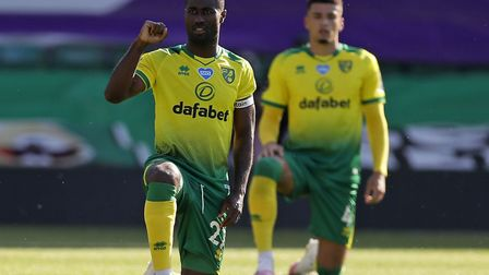 Alex Tettey takes a knee in support of the Black Lives Matter movement, as all Norwich City and Prem