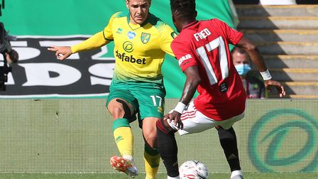 Emi Buendia is challenged by Manchester United midfielder Fred during Norwich City's defeat in the F