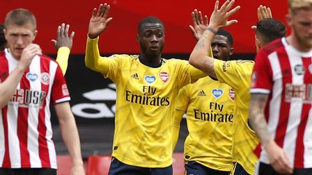 Arsenal's Nicolas Pepe celebrates scoring his side's first goal of the game during an FA Cup quarter
