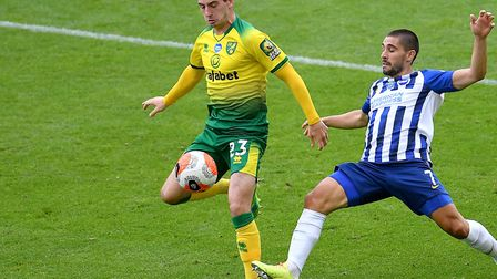 Canaries midfielder Kenny McLean is challenged by Brighton striker Neal Maupay, right, at Carrow Roa