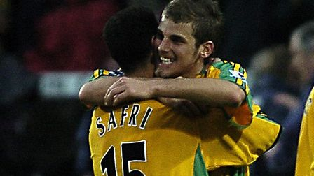 David Bentley and Youssef Safri celebrate after the final whistle as Norwich beat Manchester United
