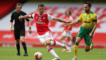 Arsenal's Granit Xhaka keeps Lukas Rupp at a safe distance in midweek Picture: PA