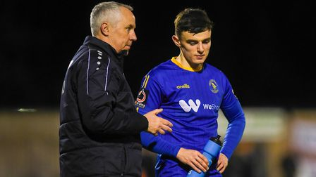 Ian Culverhouse speaking to Canaries loan player Simon Power, who had a fine spell at King's Lynn To