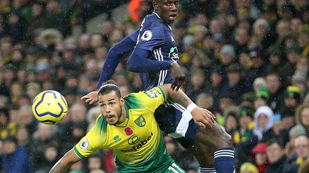 Abdoulaye Doucoure of Watford and Onel Hernandez of Norwich in action during the Hornets' crucial 2-