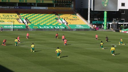 The players take a knee before a match at Carrow Road Picture: Paul Chesterton/Focus Images Ltd