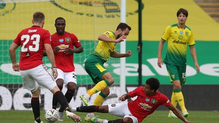 Lukas Rupp of Norwich and Jesse Lingard of Manchester United in action during the FA Cup quarter fin