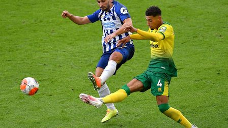 Ben Godfrey clears under pressure from Brighton striker Neal Maupay during Norwich City's defeat at