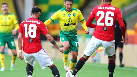 Emi Buendia takes on Bruno Fernandes, left, and Mason Greenwood during Norwich City's defeat to Manc