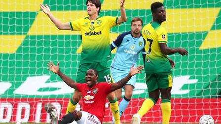 United striker Odion Ighalo was hauled down by Timm Klose at Carrow Road Picture: Catherine Ivill/NM
