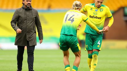 Ben Godfrey pulls Todd Cantwell to his feet after Norwich City's defeat to Brighton, as head coach D