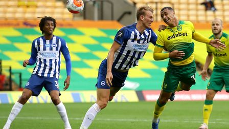 Young striker Adam Idah his the post during injury-time with this determined header as Norwich were