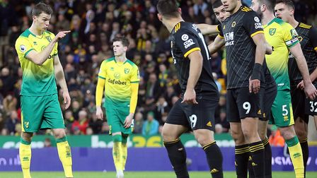 Christoph Zimmermann and Grant Hanley of Norwich decide tactics before attacking a corner during Nor