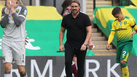 Daniel Farke tries to console his players after Norwich City's relegation from the Premier League wa