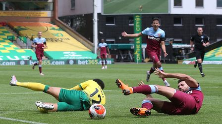 West Ham's Ryan Fredericks is fouled by Jamal Lewis during Saturday's game at Carrow Road Picture: P