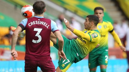 Emi Buendia has his eyes on the ball as Aaron Cresswell looks to challenge Picture: Paul Chesterton/