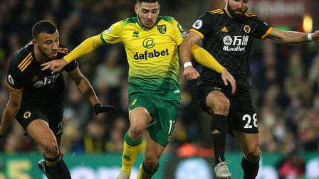 Emiliano Buendia of Norwich is fouled by Joao Moutinho of Wolverhampton Wanderers during the Premier