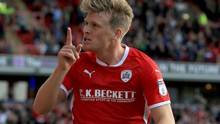 Cameron McGeehan in Championship action for Barnsley Picture: PA