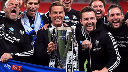 Fulham manager Scott Parker and his back room staff celebrate after winning the Championship play-of
