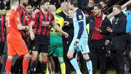 Jason Tindall, second from right, tries to help calm tempers during Bournemouth's loss to Norwich in