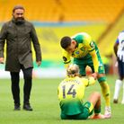 Ben Godfrey consoles a seated Todd Cantwel after another Norwich City defeat Picture: PA