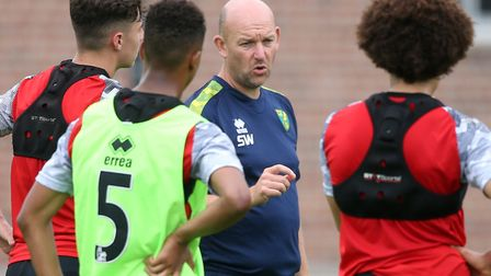 Steve Weaver speaking to Norwich City's under-23s during their pre-season training camp in Germany l