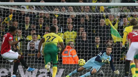 Anthony Martial's spot-kick was saved by Tim Krul on a day the Norwich keeper saved two penalties, d