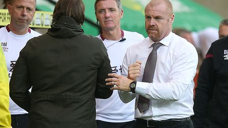 The managers bump fists at the final whistle. Picture: Paul Chesterton/Focus Images Ltd