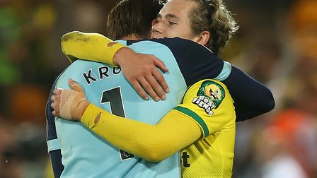 Todd Cantwell and Tim Krul celebrate victory over Manchester City in September Picture: Paul Chester
