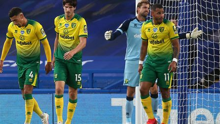 The Norwich players look dejected after conceding just before half-time during their 1-0 loss at Che