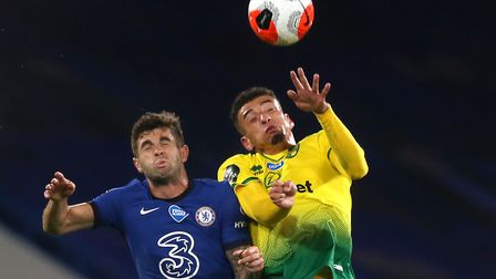 Ben Godfrey of Norwich and Christian Pulisic of Chelsea in action during the Premier League match at