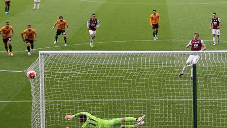 Chris Wood converted a penalty during injury-time to grab a point for Burnley against Wolves Picture