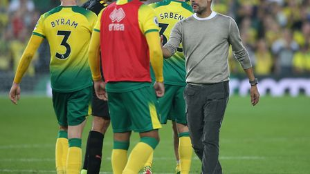 Pep Guardiola shake hands with the Norwich players after a surprise defeat for the then champions at