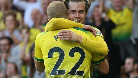 Scorers Todd Cantwell and Teemu Pukki celebrate as Norwich City memorably beat Manchester City 3-2 a