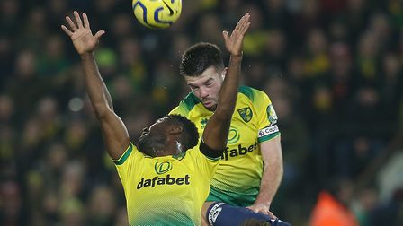 Canaries skipper Grant Hanley proved his aerial importance when he was fit during this season Pictur