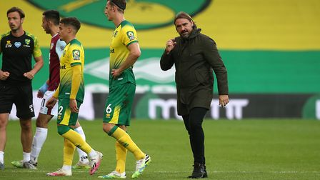 Head coach Daniel Farke, Max Aarons and Christoph Zimmermann trudge off after the defeat by Burnley