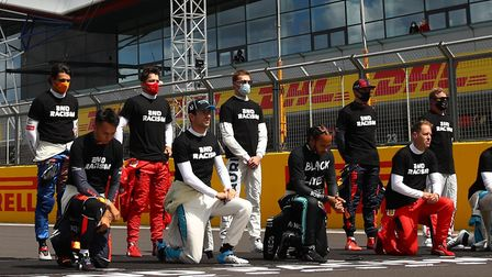 F1 drivers take a knee and wear a 'Black Lives Matter' t-shirt ahead of the Silverstone Grand Prix.