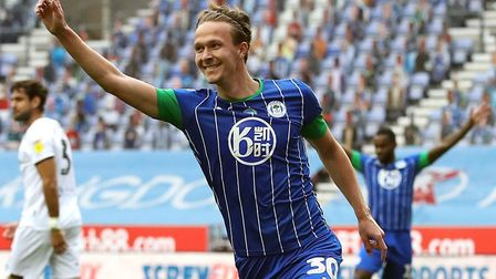 Norwich City new boy Kieran Dowell celebrates completing his hat-trick for Wigan against Hull in the