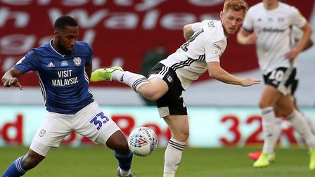 Cardiff City's Junior Hoilett and Fulham's Harrison Reed (right) battle for the ball during the Sky
