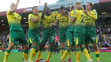 Norwich City players celebrate during their famous 3-2 win over Manchester City in September. Pictur