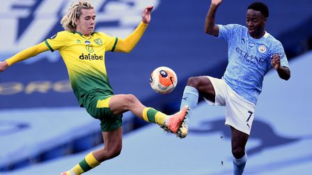 Todd Cantwell challenges England star Raheem Sterling during Norwich City's heavy loss at Manchester