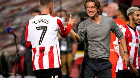 Brentford manager Thomas Frank celebrates play-off victory over Swansea with Sergi Canos at Griffin