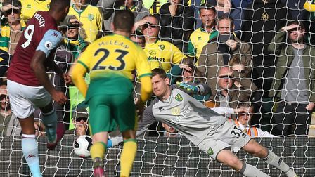 Michael McGovern saved a penalty during Norwich City's 5-1 home loss to Aston Villa in the Premier L