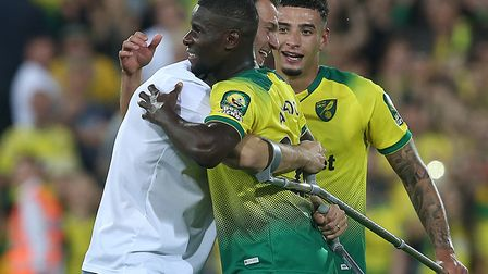 Christoph Zimmermann came on to the Carrow Road pitch on crutches to congratulate Ibrahim Amadou aft