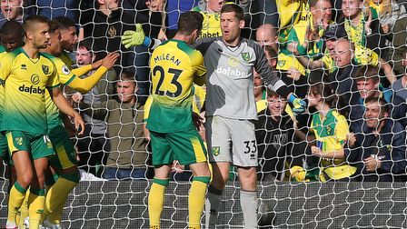 Michael McGovern is congratulated by his Norwich team-mates after saving a penalty against Aston Vil