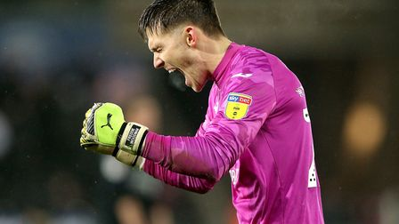 Swansea City goalkeeper Freddie Woodman celebrates the victory after the Sky Bet Championship match