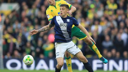 Norwich City defender Timm Klose trying to keep tabs on Jordan Hugill during Preston's 1-0 Champions