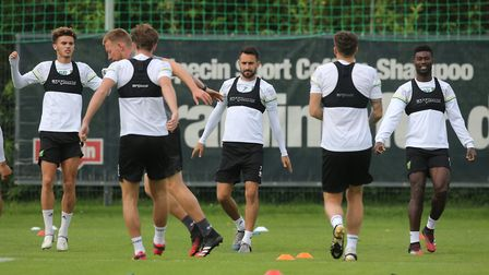Josh Martin of Norwich, Lukas Rupp of Norwich and Alexander Tettey of Norwich during training at Hot