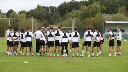 Norwich Assistant Head Coach Eddie Riemer speaks to the Norwich players during training at Hotel-Re